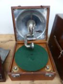 A LEATHER CASED DECCA WIND UP GRAMOPHONE, THE PLAYING ARM FITTING WITHIN THE SOUND BOX INSIDE THE
