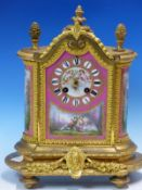 AN ORMOLU MOUNTED PORCELAIN CLOCK THE PAINTED PANELS ON A ROSE POMPADOUR GROUND, THE JAPY FRERES