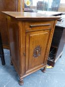 AN OAK RASIN RECORD FILE, THE CENTRALLY CARVED DOOR OPENING ONTO EIGHT PULL OUT SLIDES, THE CABINET.