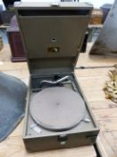 A BOAT RACE GREEN LEATHERETTE CASED HIS MASTERS VOICE WIND UP GRAMPHONE WITH CAMBRIDGE RETAILERS LAB