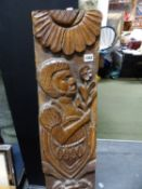 AN ANTIQUE CARVED HARDWOOD SHIPS TIMBER ELEMENT DEPICTING SPOUTING FISH AND NATIVE AFRICAN HOLDING A