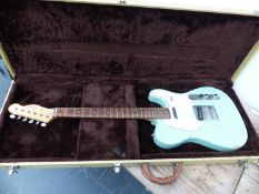 A COPY OF A FENDER TELECASTER ELECTRIC GUITAR IN HARD CARRYING CASE.