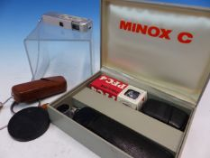 A BOXED MINOX C CAMERA WITH FLASH ATTACHMENT AND INSTRUCTION BOOKLETS TOGETHER WITH ANOTHER