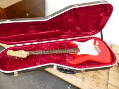 A SQUIRE ELECTRIC GUITAR IN CARRYING CASE.