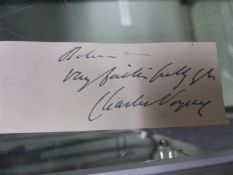 AN INK SIGNATURE OF CHARLES VOYSEY.