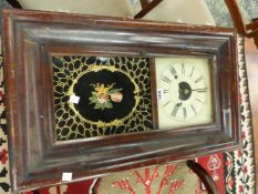 AN AMERICAN GLAZED MAHOGANY CASED WALL CLOCK BY BREWSTER AND INGRAHAMS, THE MOVEMENT STRIKING ON A