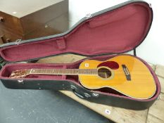 A COPY OF A GIBSON ACCOUSTIC GUITAR, No 38090 WITH A CARRYING CASE. NOTE THIS GUITAR IS A RE-BADGED