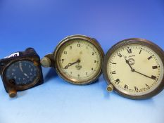 THREE CAR CLOCKS, ONE BY JAEGER. Dia. 9.5cms. ANOTHER BY SMITHS, Dia. 9cms. THE LAST IN BLACKENED