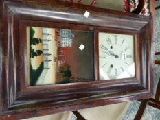 AN AMERICAN GLAZED MAHOGANY CASED WALL CLOCK BY CHAUNCEY JEROME, THE MOVEMENT STRIKING ON A COILED