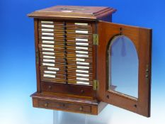 A VICTORIAN GLAZED MAHOGANY CABINET OF SIXTEEN DRAWERS OF MICROSCOPE SLIDES LARGELY PRIVATELY