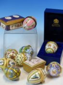 A COLLECTION OF SEVENTEEN HALCYON DAYS AND OTHER ENAMEL EASTER EGGS TOGETHER WITH SEVEN VARIOUS