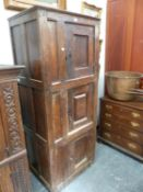 AN 18th.C.AND LATER DUTCH OAK HALL CABINET WITH THREE PANEL DOORS. W.75 x D.55 x H.186cms.