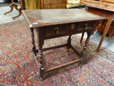 AN 18th.C.OAK SIDE TABLE WITH FRIEZE DRAWER OVER BOBBIN TURNED LEGS AND STRETCHER. W.77 x D.45. x