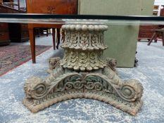 AN ANTIQUE CARVED HARDWOOD PEDESTAL WITH LATER PLATE GLASS TOP.
