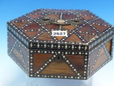 A MATARA SRI LANKHA HEXAGONAL BOX THE HINGED LID INLAID WITH SPECIMEN WOODS IN TRIANGLES DEFINED