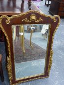 A WALNUT AND GILT FRAMED GEORGIAN STYLE WALL MIRROR. 57 x 84cms.