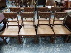 AN INTERESTING SET OF EIGHT VICTORIAN GOTHIC REVIVAL OAK HALL CHAIRS WITH CARVED BACKS, TURNED