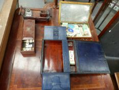 A 19th.C. MAHOGANY SLIDE TOP BOX CONTAINING DOMINOES, A RUSTIC OAK DESK STAND, A LEATHER BOUND