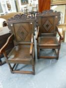 A PAIR OF LATE 17th.C.STYLE OAK WAINSCOT CHAIRS WITH CARVED BORDERS AND SCROLLWORK PEDIMENT.