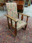 A MORRIS TYPE RECLINING BACK ROCKING ARMCHAIR.