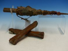 A PAIR OF ANCIENT BONES, POSSIBLY WORKED AS ICE SKATES. W 21.5cms. TOGETHER WITH A WEST AFRICAN IRON