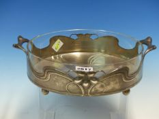 A CUT GLASS LINED ORIVIT ART NOUVEAU PEWTER TWO HANDLED CIRCULAR BOWL. Dia. 20cms.