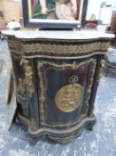 A FRENCH 19th.C.EBONISED ORMOLU MOUNTED MARBLE TOP CABINET, SERPENTINE FORM WITH FIGURAL MOUNTS