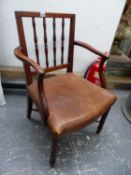 A GEORGE III MAHOGANY ELBOW CHAIR WITH FOUR TURNED UPRIGHTS TO THE SQUARED BACK, THE LEATHER SEAT ON
