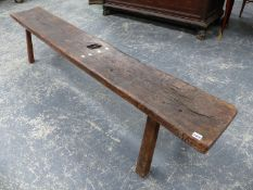 AN ANTIQUE RUSTIC OAK LONG BENCH ON SQUARE PEG LEGS. L.234 x H.46cms