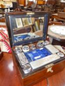 A WALNUT CASED SILVER ON COPPER FITTED DRESSING AND JEWELLERY BOX, A BLUE VELVET LINED LIFT OUT TRAY
