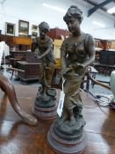 A PAIR OF BRONZED SPELTER FIGURES AFTER AUGUSTE MOREAU, THE LADIES HOLDING SONG BIRDS, RED MARBLED