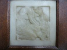 AN OAK FRAMED WHITE MARBLE RELIEF PANEL CARVED WITH A MOTHER KNEELING TO RUB HEADS WITH HER BABY