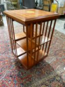 AN EDWARDIAN STYLE MAHOGANY AND INLAID SMALL REVOLVING BOOKCASE. 48 x 48 x H.79cms.