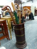 A MAHOGANY AND BRASS BOUND STICK STAND AND A QUANTITY OF WALKING STICKS, ETC.