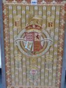 A SILK WORKED PANEL CELEBRATING THE CORONATION OF EDWARD VII WITH HIS ARMORIAL ABOVE THE NATIONAL