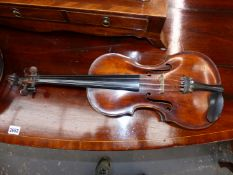 A PARIS MADE VIOLIN BEARING AN INDISTINCT MAKERS MARK AT THE TOP OF THE BACK AND IN A LEATHERETTE