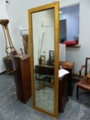 AN ANTIQUE GILT FRAMED PIER/ROBING MIRROR. W 59 x H 197cms.