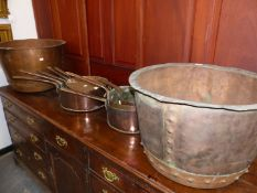 TWO COPPER COPPERS TOGETHER WITH A GRADUATED SET OF FOUR SAUCEPANS, ONE LID AND ANOTHER SET OF THREE