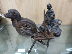 A PAINTED POTTERY MODEL OF A SEATED DACHSHUND. H 19cms. A WOODEN MODEL OF A SPINNING MACHINE