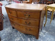 AN EARLY 19TH CENTURY MAHOGANY BOWFRONT FOUR DRAWER CHEST.