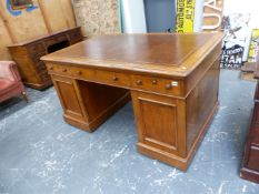 A LARGE VICTORIAN OAK TWIN PEDESTAL PARTNER'S DESK WITH ARRANGEMENT OF THREE FRIEZE DRAWERS OVER