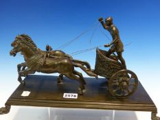 A 19th C. BRONZE GROUP OF A ROMAN CHARIOTEER DRIVING TWO HORSES, RECTANGULAR PLINTH. W 37cms.