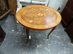 A FLORAL MARQUETRY OVAL COFFEE TABLE ON CABRIOLE LEGS WITH FOLIATE ORMOLU MOUNTED FEET. W 71 x D