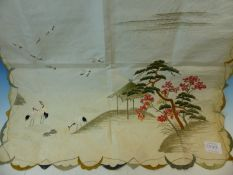 A JAPANESE WHITE SILK PANEL EMBROIDERED WITH CRANES IN SHALLOW WATER AND FLYING ABOUT ISLANDS