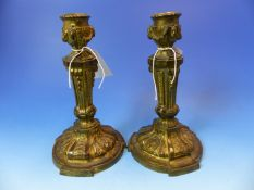A PAIR OF GILT BRONZE CANDLESTICKS CAST IN THE HUGUENOT TASTE, EACH FOOT WITH THREE FOLIATE STRAPS