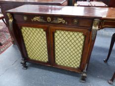 A ROSEWOOD REGENCY AND LATER EGYPTIAN REVIVAL ORMOLU MOUNTED SIDE CABINET, SHALLOW DROP FRONT DRAWER