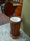 A VICTORIAN MAHOGANY CYLINDER FORM LIFT TOP BEDSIDE CABINET, WITH WASH BASIN. Dia.42 x H.78cms.