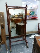 A REGENCY MAHOGANY CHEVAL MIRROR ON TURNED COLUMN SUPPORTS AND SABRE LEGS 84 CM WIDE X 178 CM HIGH.
