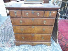 AN 18th.C. AND LATER WALNUT CHEST OF THREE SHORT AND THREE LONG GRADUATED DRAWERS ON SHAPED PLINTH