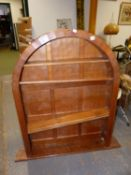 AN ARTS AND CRAFTS ACORN MAN OAK PANEL BACK ARCHED TOP BOOKCASE WITH ADZE FINISH. W.93 x D.17 x H.